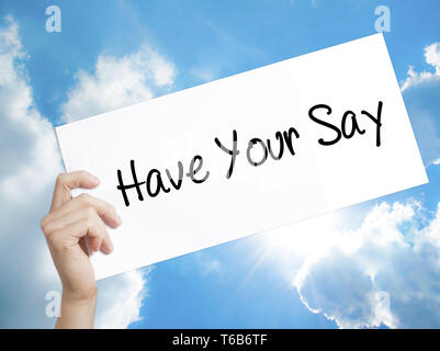 Have Your Say Sign on white paper. Man Hand Holding Paper with text. Isolated on sky background - Stock Photo