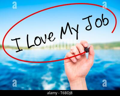 Man Hand writing I Love My Job  with black marker on visual screen - Stock Photo