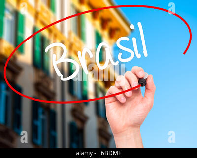 Man Hand writing Brasil ( Brazil  in Portuguese) with black marker on visual screen - Stock Photo