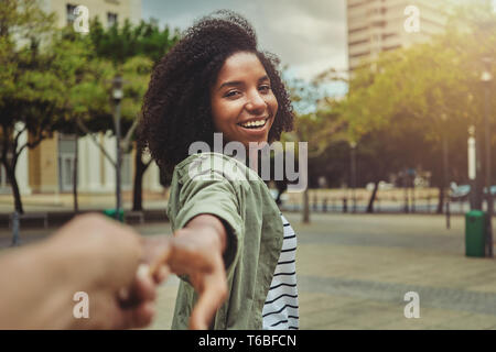 Boyfriend following his happy girlfriend in the city