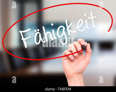 Man Hand writing Fahigkeit (Ability in German) with black marker on visual screen - Stock Photo