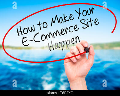 Man Hand writing How to Make Your E-Commerce Site Happen with black marker on visual screen. - Stock Photo