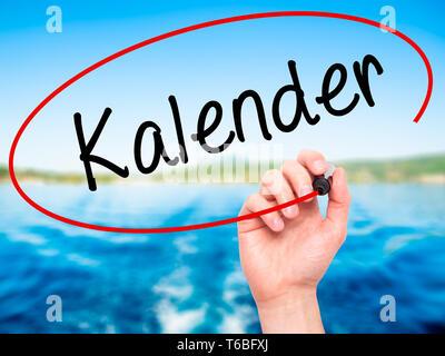 Man Hand writing Kalender (Calendar in German)  with black marker on visual screen - Stock Photo