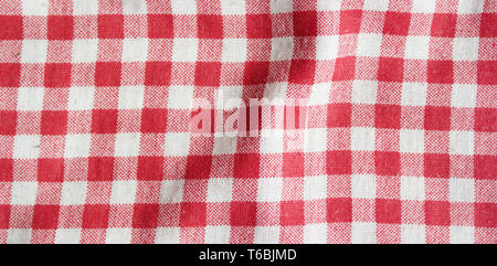Red linen picnic tablecloth. Texture of checkered picnic blanket. - Stock Photo
