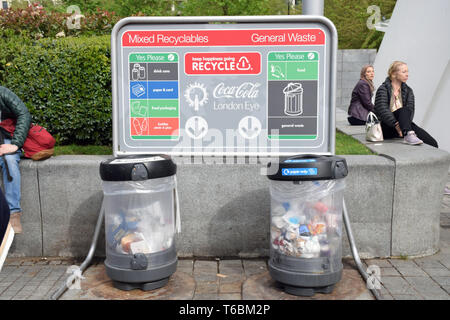 Recycling and waste bins in front of the Coca Cola London Eye, London April 2019 UK - Stock Photo