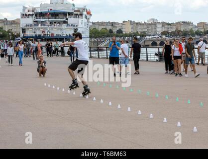 Bordeaux, France - September 9, 2018: Roller skater performs acrobatics in Quai Louis XVIII in Bordeaux, France - Stock Photo