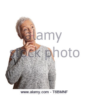 concerned mature woman looking up - Stock Photo