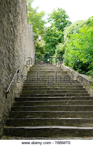 old stone steps leading up hill - Stock Photo