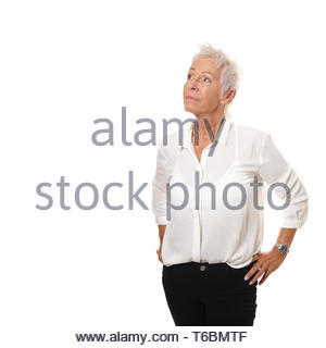 older woman looking up at copy space - Stock Photo