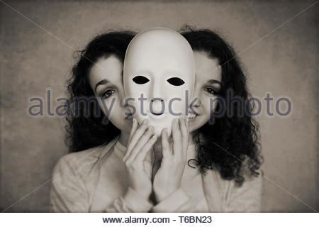 two-faced woman manic depression concept - Stock Photo