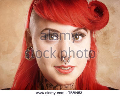 girl with piercings and tattoos - Stock Photo