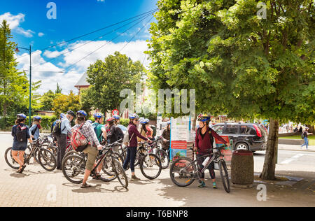 8 January 2019: Christchurch, New Zealand - Group of bicycle tourists gather on a lovely summer day in Christchurch, New Zealand. - Stock Photo