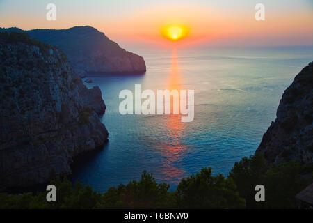 Sunset from Hacienda Na Xamena Hotel. Sant Miquel. Ibiza. Balearic Islands. Spain. - Stock Photo