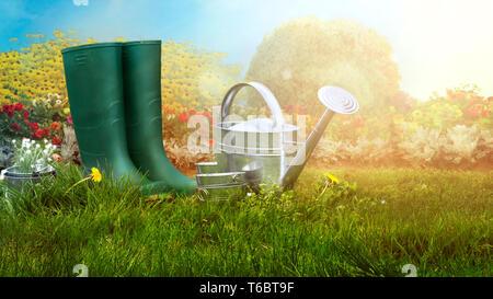 Spring garden. Boots and gardening tools in green grass. Garden concept
