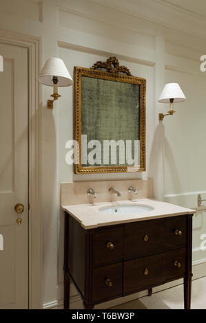 Ornate frame and sink in bathroom - Stock Photo