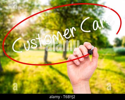 Man Hand writing Customer Care with black marker on visual screen - Stock Photo