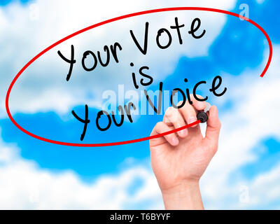 Man Hand writing Your Vote is Your Voice with black marker on visual screen - Stock Photo