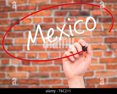 Man Hand writing Mexico  with black marker on visual screen - Stock Photo