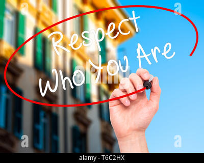 Man Hand writing Respect Who You Are with black marker on visual screen. - Stock Photo