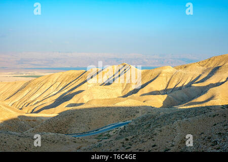 Palestine, West Bank, Jericho. View towards the Dead Sea and Jordan from Wadi Quelt. - Stock Photo