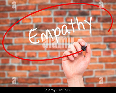 Man Hand writing Empathy with black marker on visual screen - Stock Photo