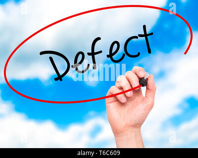 Man Hand writing Defect with black marker on visual screen - Stock Photo