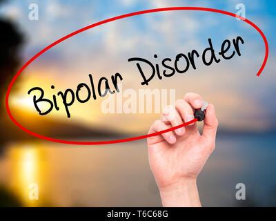 Man Hand writing Bipolar Disorder with black marker on visual screen - Stock Photo