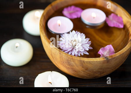 Aroma candles, aroma sticks, rose water, flower petals. Items for aromatherapy, massage. Relax and spa theme - Stock Photo
