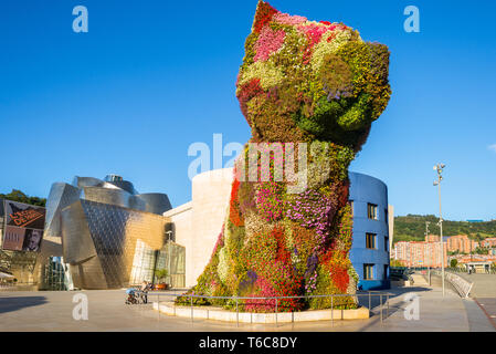 Dog from flowers in the mid town of Bilbao - Stock Photo