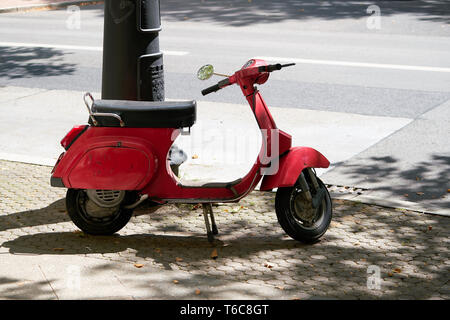 Scooter on the roadside at the Kurfuerstendamm in Berlin - Stock Photo