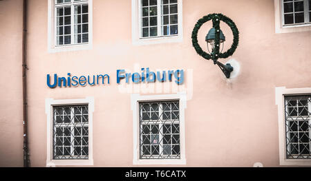 Freiburg im Breisgau, Germany - December 31, 2017 - People walking in front of Uniseum City University Museum on a winter day - Stock Photo