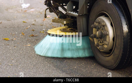 Process of cleaning street with a modern cleaning machine on streets of a big city in Europe - Stock Photo