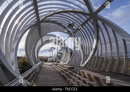 Arganzuela footbridge over Manzanares River in Madrid Rio recreational area in Madrid, Spain - Stock Photo