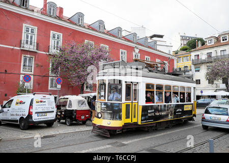 Tourists looking out the window of a Lisbon tram 28 in spring in the Alfama district of Lisbon Portugal Europe EU  KATHY DEWITT - Stock Photo