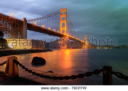 Golden Gate Bridge and Chainlink Fence at Night. - Stock Photo