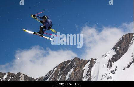 skier jumping on a snow park - Stock Photo