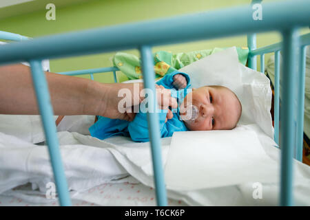 Newborn baby infant in the hospital - Stock Photo