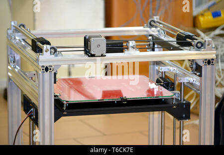 3d printer construction top. Automatic three dimensional 3d printer performs plastic yellow colors modeling in laboratory. - Stock Photo