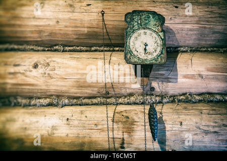 Old clock on a wooden wall - Stock Photo