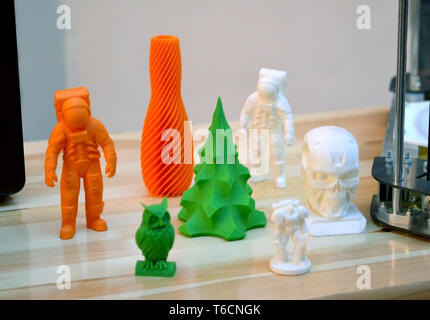 Bright colorful objects printed by a 3d printer close-up. Progressive modern additive technology. Copy spase, spase for text. - Stock Photo