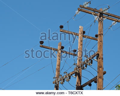A grid view ,electric current pylon and cables - Stock Photo
