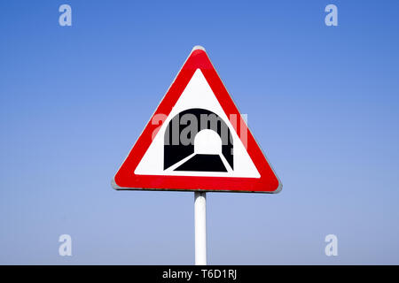 A road sign warning about the tunnel. - Stock Photo