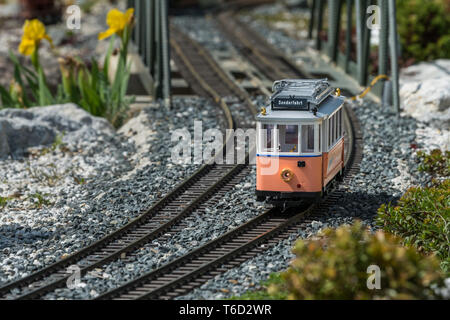 Railway modelling train outdoors on a sunny day, single engine - Stock Photo