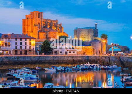Spain, Cantabria, Castro-Urdiales, harbour, Santa Maria church and Santa Ana castle at dusk