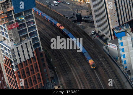 A train travels along the tracks out of Vauxhall Station through construction in Nine Elms south London. April 13, 2019. - Stock Photo