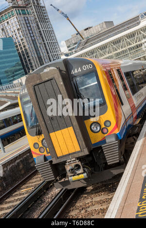 a south western railway class 444 electric multiple unit commuter train in a platform at London waterloo railway station. - Stock Photo