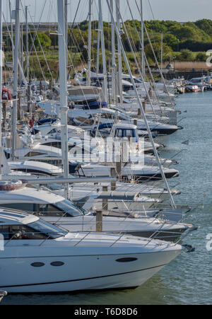 expensive large motorboats and yachts in a marina at Lymington in the new forest, Hampshire, England. - Stock Photo