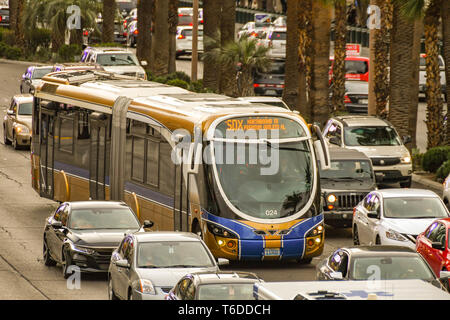 LAS VEGAS, NEVADA, USA - FEBRUARY 2019: express bus travelling down Las Vegas Boulevard, which is also known as 'The Strip'. - Stock Photo