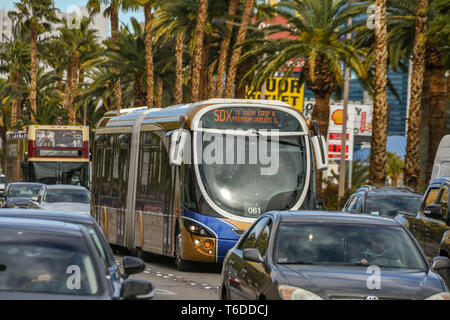 LAS VEGAS, NEVADA, USA - FEBRUARY 2019: Modern express bus on the SDX route driving along Las Vegas Boulevard - The Strip - in heavy traffic - Stock Photo