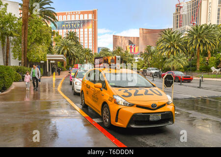 LAS VEGAS, NEVADA, USA - FEBRUARY 2019: Line of taxi cabs waiting outside the Mirage Hotel in Las Vegas. - Stock Photo